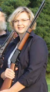 Amanda Suffecool holds a lever action .22 that was donated by Henry Repeating Arms for a REALIZEfac women's program.