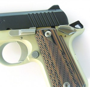 The Kimber is shown properly carried in the ready mode, hammer to the rear, safety on, or cocked and locked.