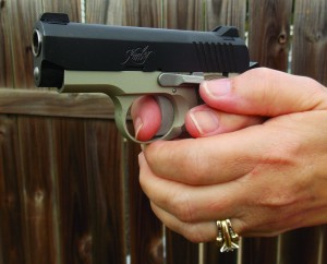 The hand fit of the Kimber is excellent. While small hands are accommodated, only the largest hands are cramped.
