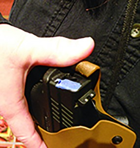 The sturdy fold-over security clip of the Safe Carry Ranger by Dou-bleClick Holsters is pushed aside by the thumb during the draw.