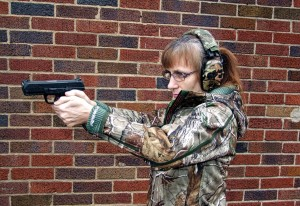 Helen shooting the Ruger American Pistol with small grip installed.
