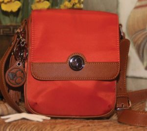 Concealed Carrie's microfiber crossbody holster bag is a summery option for purse carry.