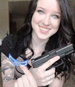 Instructor Caton, her instructor's chevron and her Glock 9mm.