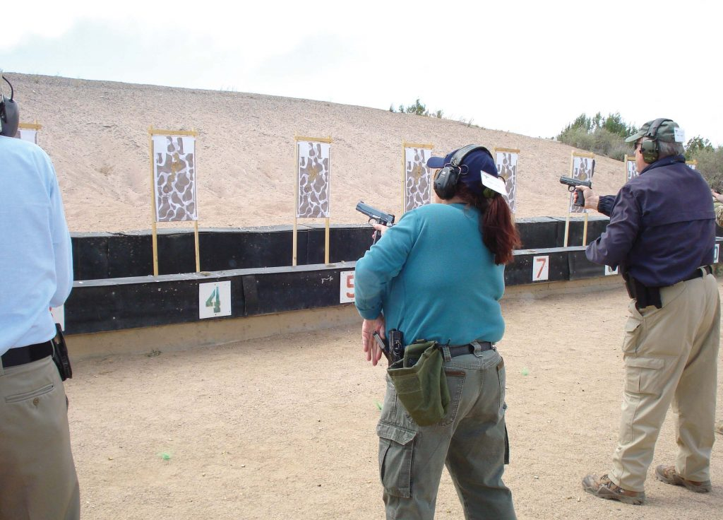 The author performs a tactical reload with her custom Ladyhawk at Gunsite Academy's 250 class. (Photo by Tom Walls)