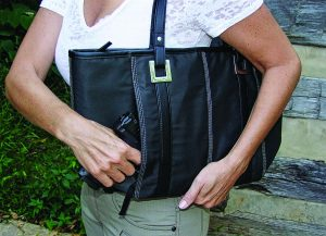 5.11 Tactical's Lucy Tote, tucks perfectly under the arm and allows easy access to an H7K VP9.